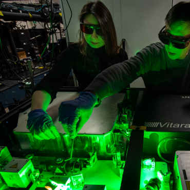 Researchers working with Ultra-Fast Laser