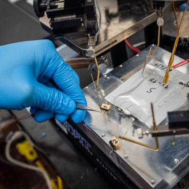 Thermal Science researcher working on experiment