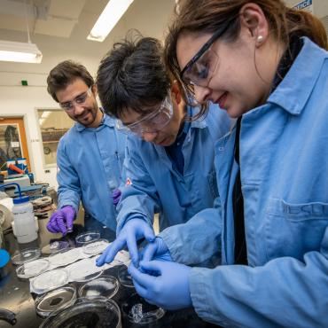 Gao and research group working on experiment